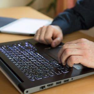 Man hands on laptop