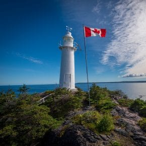 canadian flag and lighthouse
