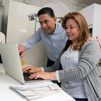 Latin American couple at home online.