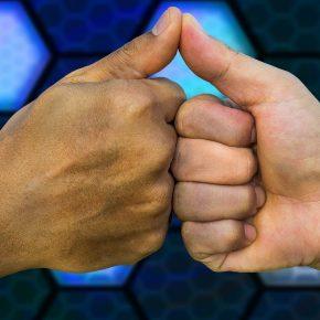 deal handshake bump