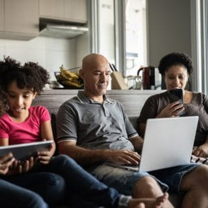Family on devices at home