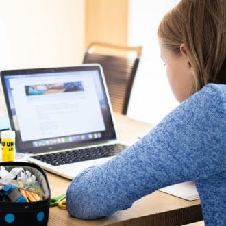 Little girl on laptop. Broadband needed for low-income famiies.