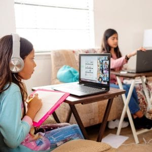 Girls at home attending school.