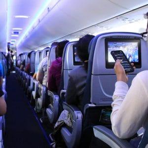 passenger on airplane on phone