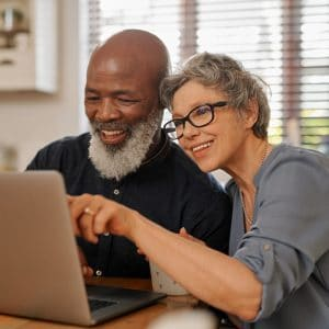 Senior couple on laptop at home