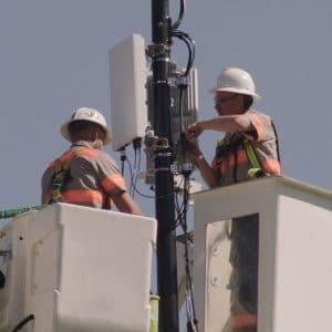 Verizon tech install 5G node