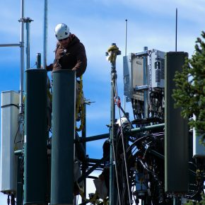 workman on cell tower